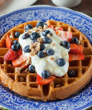 Belgian waffle with strawberries and cream